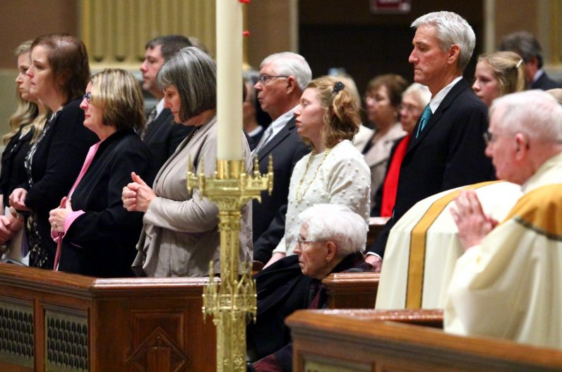 Bishop Lohmuller's family, many of whom traveled from Indiana, attended the funeral, including his sister-in-law Genevieve Lohmuller, 92 (seated).