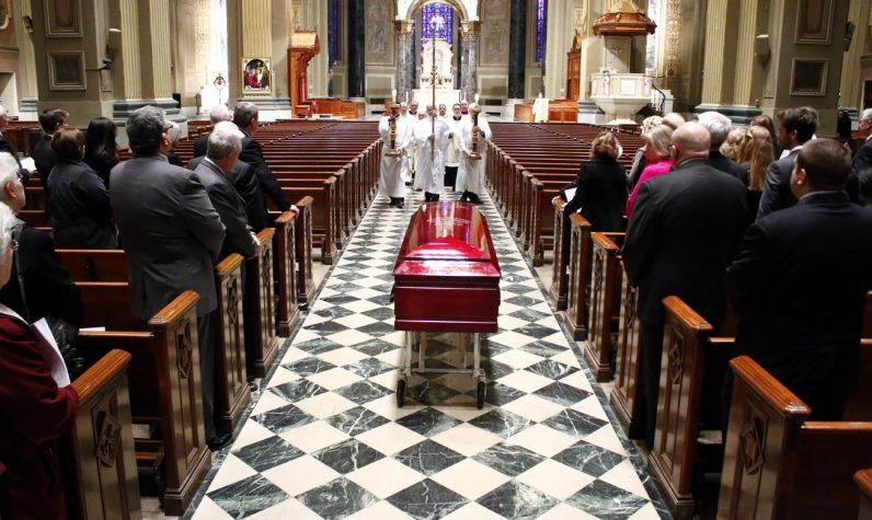 Bishop Martin Lohmuller's body is received at the Cathedral Basilica of SS. Peter and Paul.