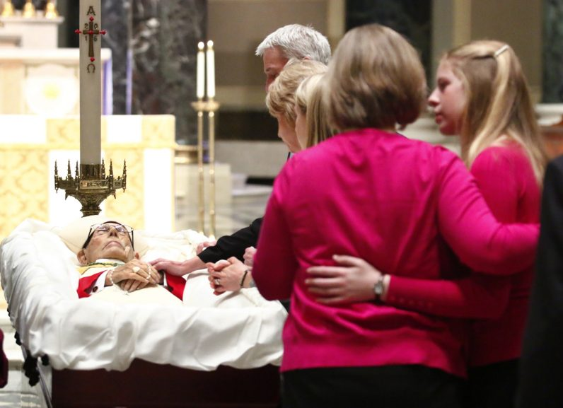 Bishop Martin Lohmuller's family members say a final goodbye at the Cathedral Basilica of SS. Peter and Paul in Philadelphia.