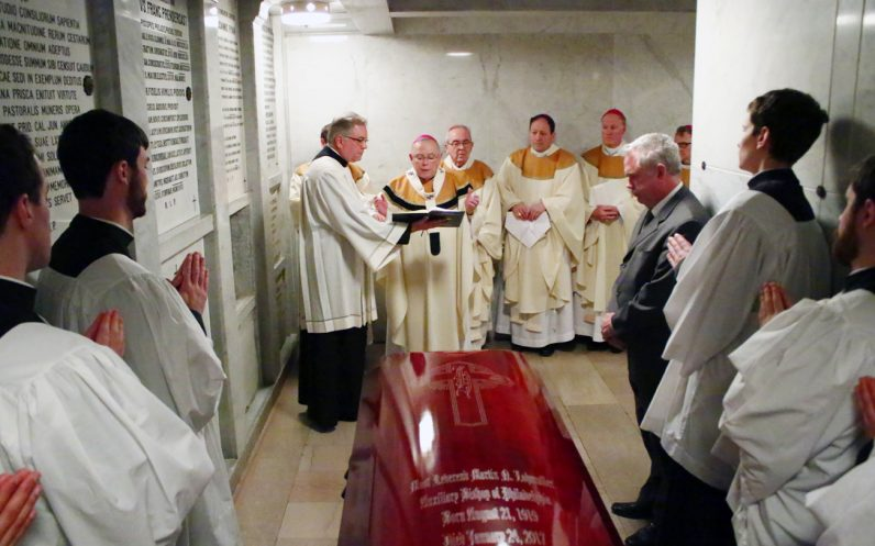 Archbishop Charles Chaput presides over the entombment of Bishop Martin Lohmuller Feb. 1 in the crypt beneath the main altar of the Cathedral Basilica of SS. Peter and Paul.