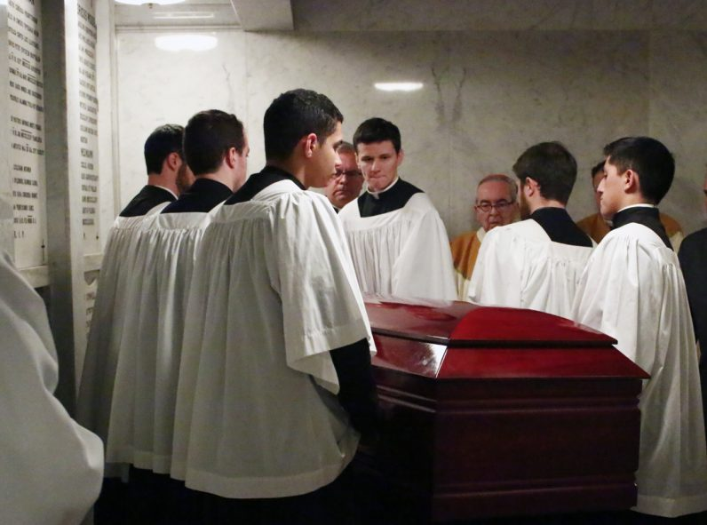 Seminarians from St. Charles Borromeo Seminary place the casket to Bishop Martin Lohmuller in the crypt located below the main altar of the Cathedral Basilica of SS. Peter and Paul in Philadelphia.
