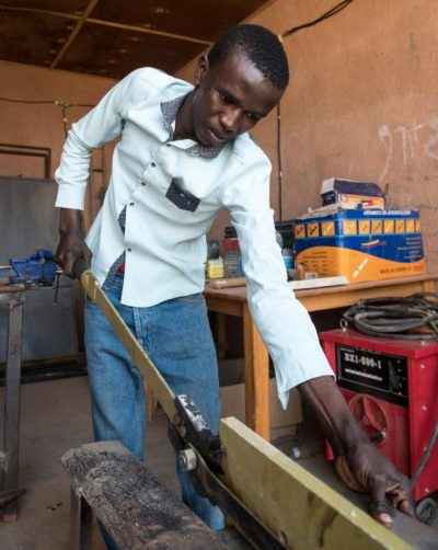 Training courses where mostly young men are taught how to cut and shape metal are run by Catholic Relief Services in Agadez, Niger, in an effort to provide alternatives to migrants who want to make the dangerous journey to Europe. (CNS/Michael Stulman, Catholic Relief Services)