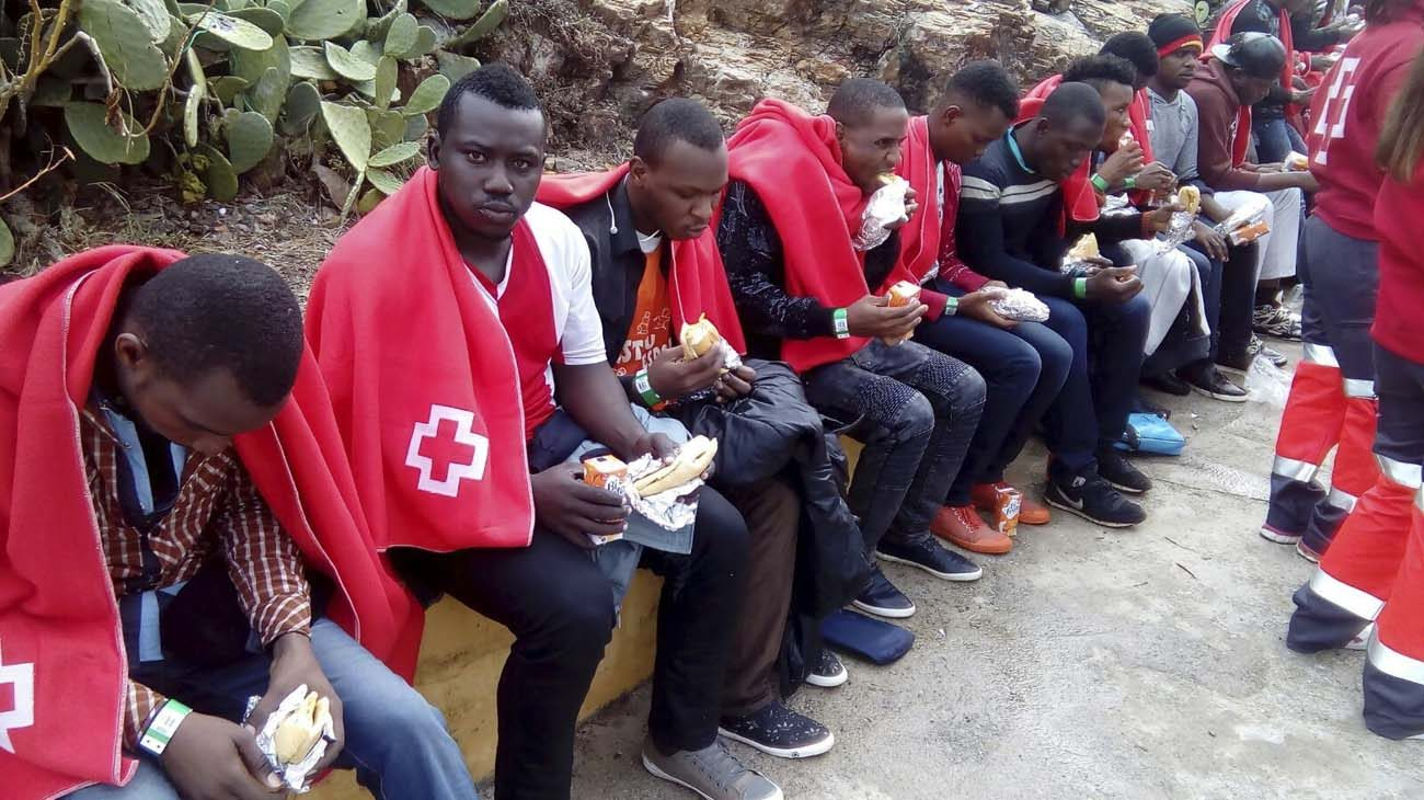 A group of migrants from sub-Saharan Africa cover themselves with blankets given by the Spanish Red Cross after being rescued off the coast of Ceuta, the Spanish enclave in North Africa, in 2016. Catholic bishops from North Africa urged greater support for church life in their region, where migrants from sub-Saharan Africa now make up a large proportion of Catholic communities. (CNS photo/Rafael Pena, EPA)