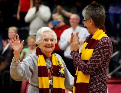 Sister Jean Dolores Schmidt, 97, waves to fans in Chicago Jan. 21 after being inducted into the Athletics Hall of Fame at Loyola University Chicago. She is the longtime chaplain for the men's basketball team. (CNS photo/Karen Callaway, Chicago Catholic)