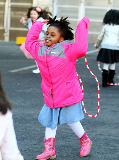 Juliet Thompson enjoys jumping rope at St. Helena's OST program. Many of the children did not know how to jump rope until learning how through the program.