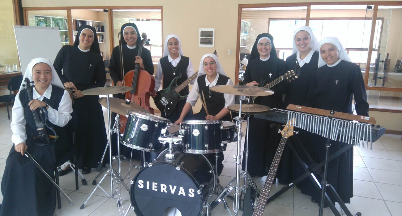 Members of the pop band Siervas pose for a photo Jan. 22 in their music room in Lima, Peru. The 12 women, who are members of the Servants of the Plan of God, have taken their inspirational music to other countries but also do social service work in Peru. (CNS photo/courtesy Lukas Isaac)