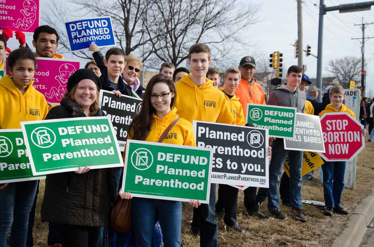 "Members of the ""Crusaders for Life"" pro-life youth group rally Feb. 11 against Planned Parenthood in Aurora, Ill. It was one of many nationwide rallies calling on Congress to end federal funding of Planned Parenthood. (CNS photo/courtesy Sam Scheidler)"