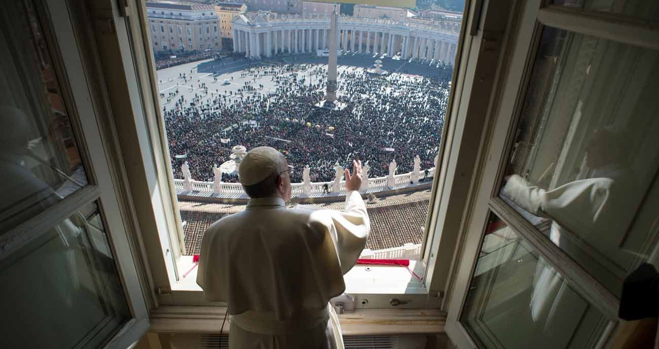 Pope Francis greets the crowd as he leads the Angelus from his studio overlooking St. Peter's Square at the Vatican in this Jan. 29, 2017, file photo. (CNS photo/L'Osservatore Romano, handout)