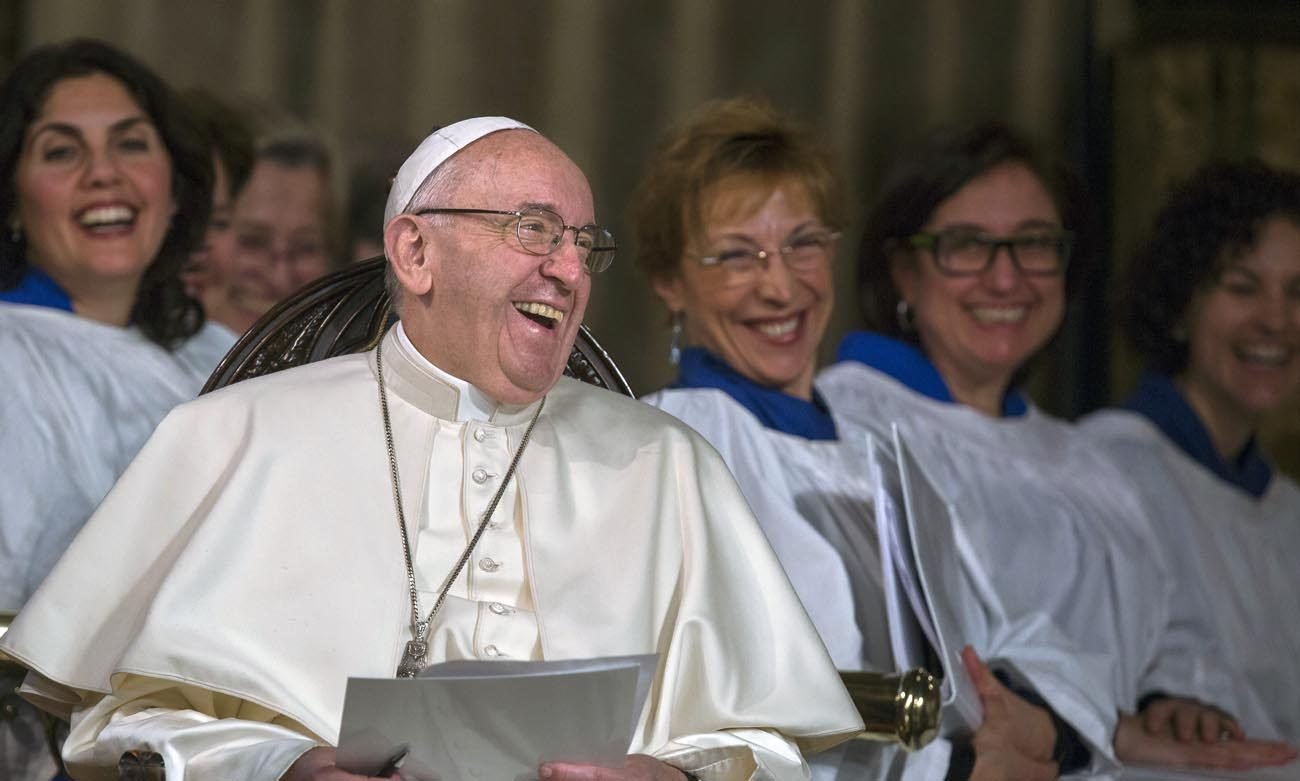 Pope Francis laughs during an evening prayer service at All Saints' Anglican Church in Rome in this Feb. 26, 2017, file photo. Joy is the sign of a true Christian who has embarked on a path of giving generously to those in need, even when enduring suffering and persecution, Pope Francis  said Feb. 28 during morning Mass at Domus Sanctae Marthae. (CNS photo/Maria Grazia Picciarella, pool)