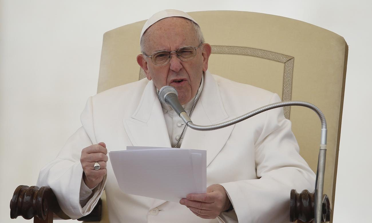 Pope Francis speaks during his general audience in St. Peter's Square at the Vatican Feb. 22. (CNS photo/Paul Haring)