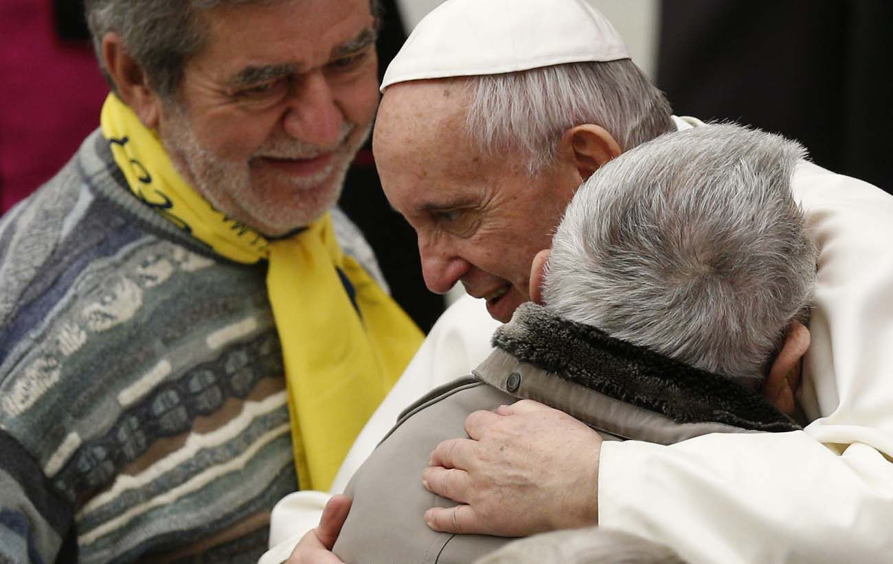 Pope Francis embraces a man while meeting the disabled during his general audience in Paul VI hall at the Vatican Feb. 1. (CNS photo/Paul Haring)