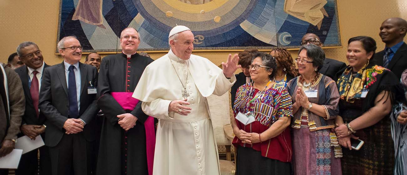 Pope Francis waves during a meeting with participants in the Indigenous Peoples' Forum of the International Fund for Agricultural Development Feb. 15 at the Vatican. (CNS photo/L'Osservatore Romano, handout)