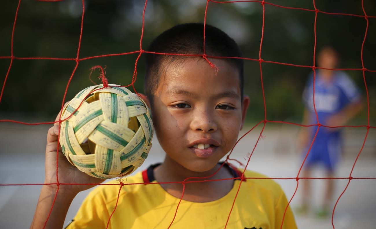 A 12-year-old orphan living with HIV poses for a photo at the Baan Dek Thammarak orphanage in Lopburi, Thailand, March 7, 2016. (CNS photo/Diego Azubel, EPA)