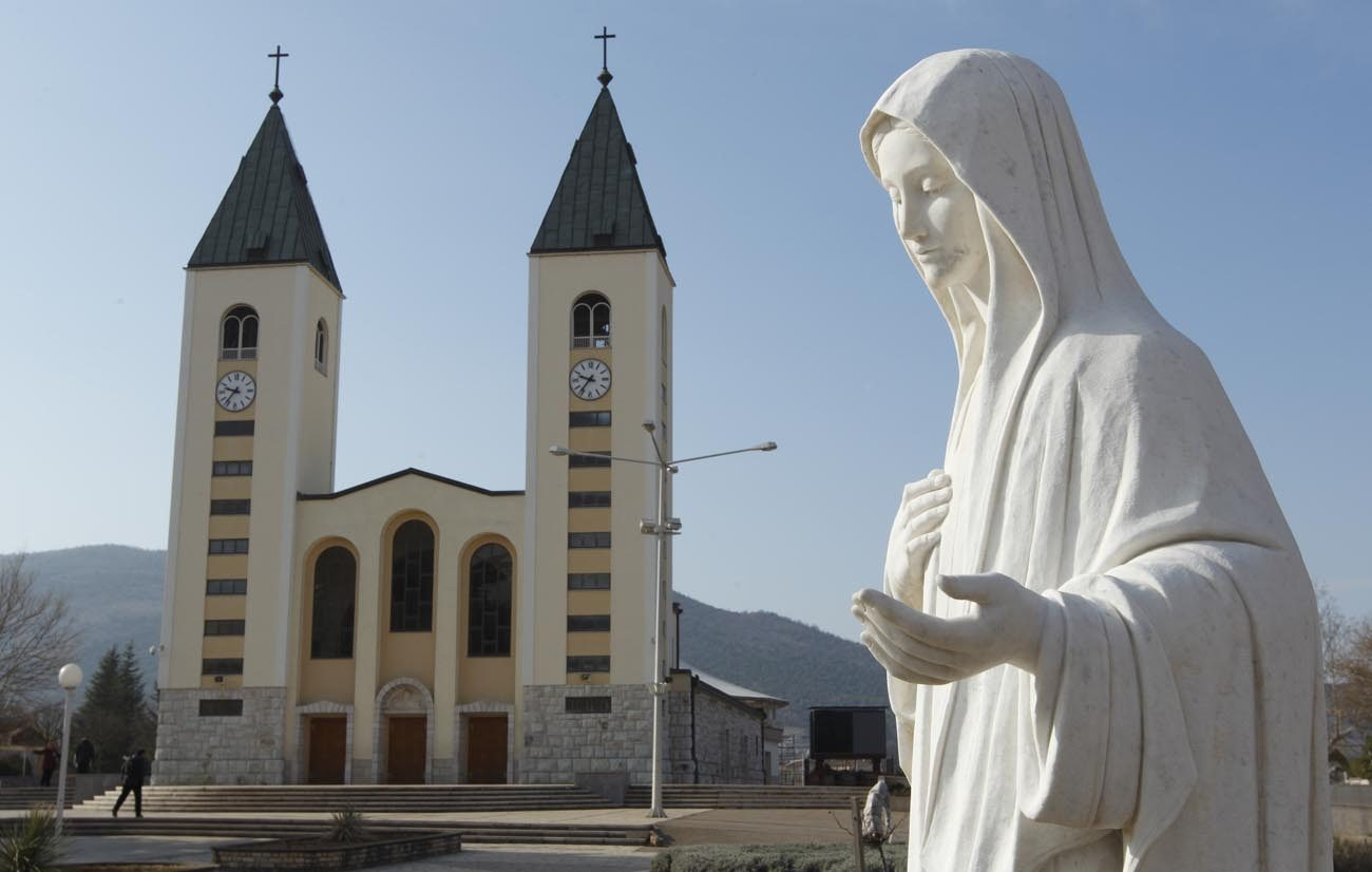 A statue of Mary is seen outside St. James Church in Medjugorje, Bosnia-Herzegovina, in this Feb. 26, 2011, file photo. Pope Francis has appointed Archbishop Henryk Hoser of Warsaw-Praga, Poland, as his special envoy to Medjugorje, the site of alleged Marian apparitions. A Vatican statement said his role would be to study the pastoral situation in Medjugorje. (CNS photo/Paul Haring)