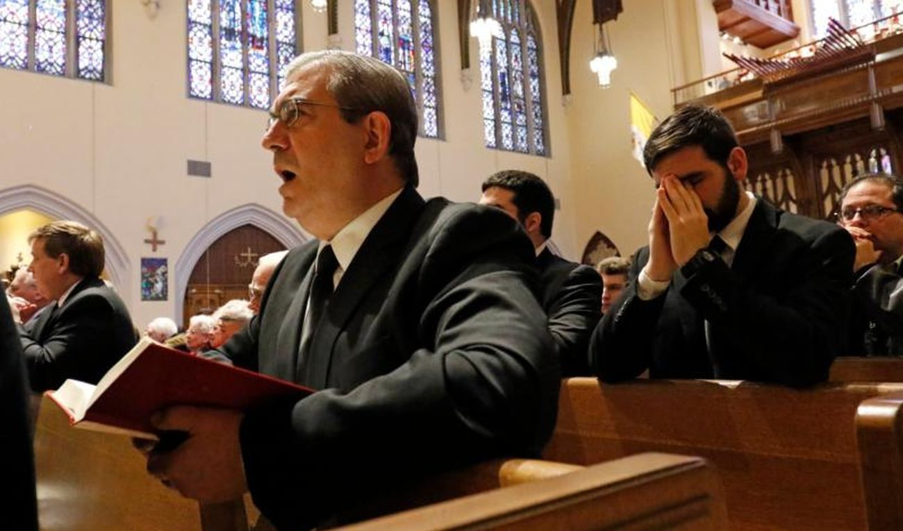 "Marianist Brother Stephen Balletta, left, prays during a Mass marking World Day for Consecrated Life Feb. 5 at St. Agnes Cathedral in Rockville Centre, N.Y. Catholic religious orders must have the courage to start new forms of outreach, knowing that the only people who ""never make mistakes are those who never do anything,"" Pope Francis said during a Feb. 9 meeting with 140 superiors general of men's religious orders. (CNS photo/Gregory A. Shemitz, Long Island Catholic)"