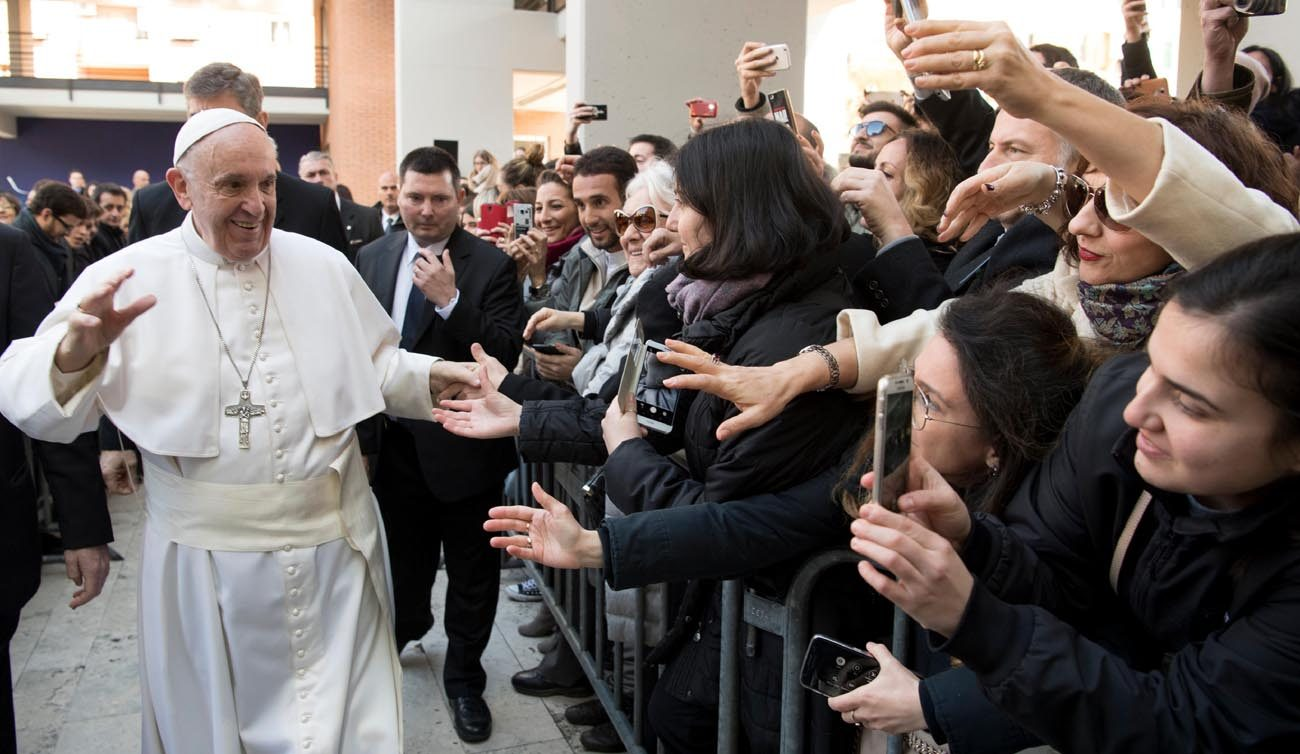 Pope Francis greets people as he arrives for a Feb. 17 meeting at Roma Tre University. (CNS photo/L'Osservatore Romano, handout)