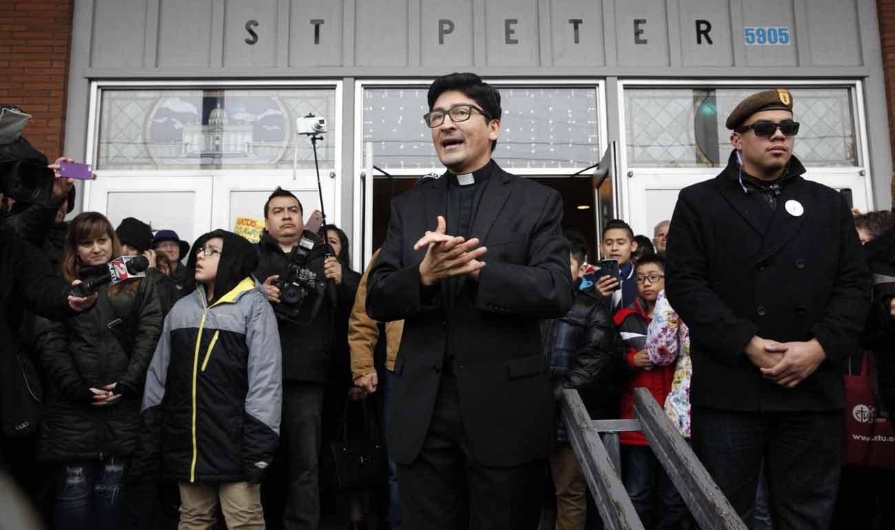 Father Raul Marquez of St. Peter Parish in Portland, Oregon, thanks people who came to stand vigil outside his church Feb. 5. The crowd formed a human shield a week after a group of eight men stood outside the front door of the church during a Spanish Mass and yelled insults about Catholicism, immigrants and the morals of the parish women. (CNS photo/Francisco Lara, Catholic Sentinel)