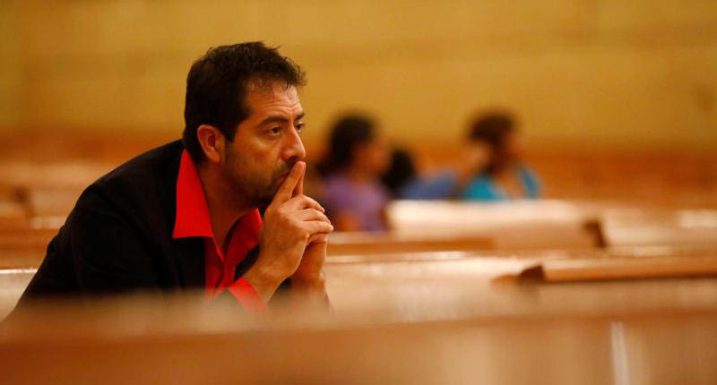 Ernesto Vega listens during a Nov. 10, 2016, prayer service at the Cathedral of Our Lady of the Angels in Los Angeles. Duke University's Center for Spirituality, Theology and Health reported in 2015 that an analysis of more than 1,500 reputable medical studies indicates people who are more religious and pray more have better mental and physical health. (CNS photo/Patrick T. Fallon, Reuters)