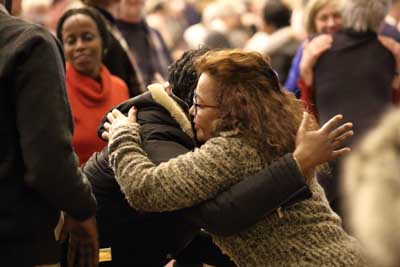 Women exchange the sign of peace during a solidarity Mass Jan. 31 at the Notre-Dame-de-Foy church in Quebec City for the six victims who were killed by a lone gunman Jan. 29 at the mosque belonging to the Quebec Islamic Cultural Center. Notre-Dame-de-Foy is located next to the mosque. (CNS photo/Philippe Vaillancourt, Presence)