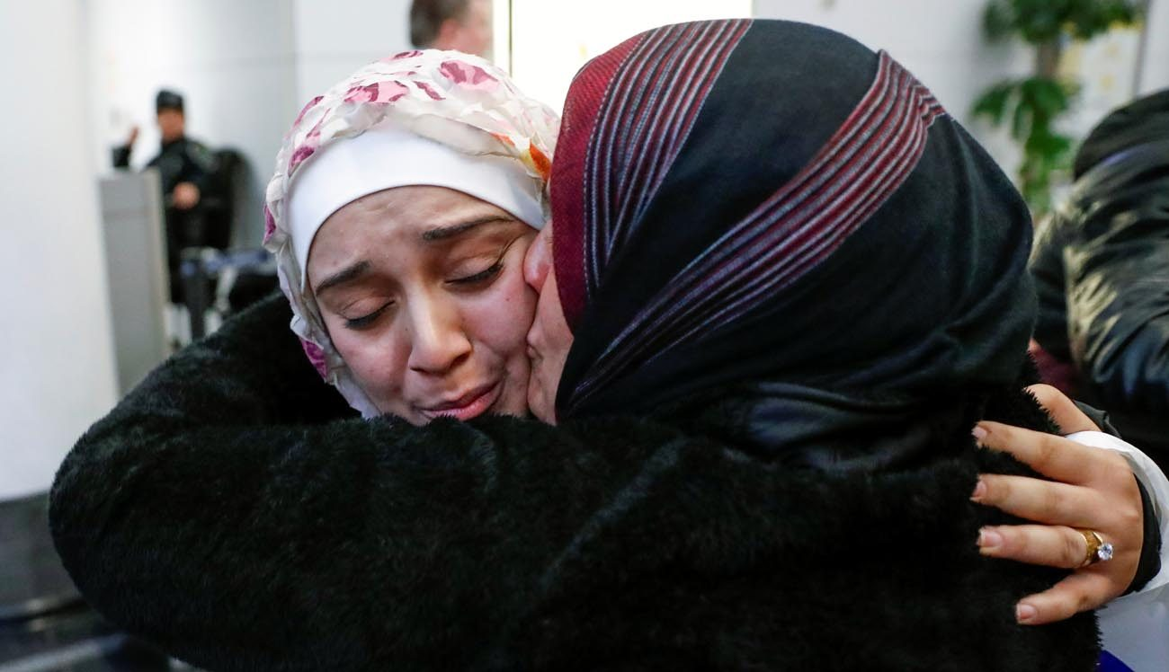 Syrian refugee Baraa Haj Khalaf is greeted by her mother, Fattoum Haj Khalaf, after arriving Feb. 7 at O'Hare International Airport in Chicago. (CNS photo/Kamil Krzaczynski, Reuters)
