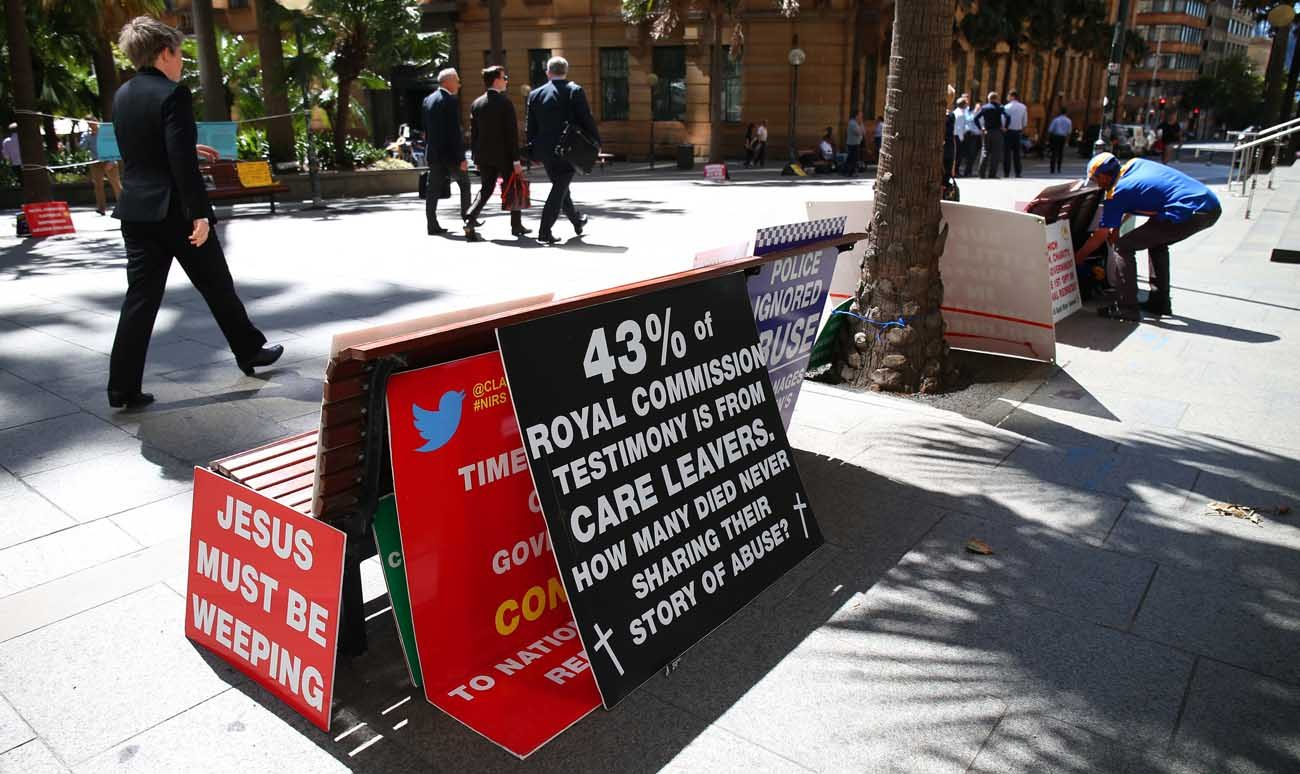 A display of protest placards sit outside the Royal Commission into Child Sex Abuse Feb. 23 in Sydney. (CNS photo/David Moir, EPA)