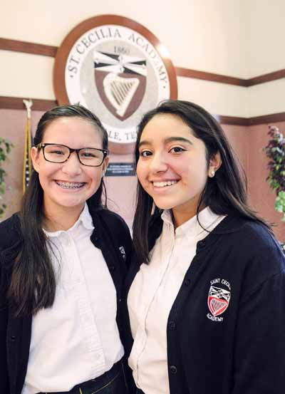 Valeria Santos and Grecia Andrade pose for a photo at St. Cecilia Academy in Nashville, Tenn., Jan. 18. (CNS photo/Andy Telli, Tennessee Register)