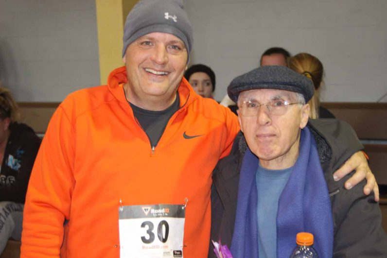 A father and his son (left) who ran in the race, enjoy time together and with fellow parishioners.