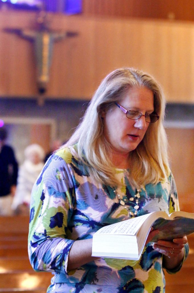 Ann Marchino sings during the opening hymn for Mass at St. Katharine of Siena Church in Wayne.