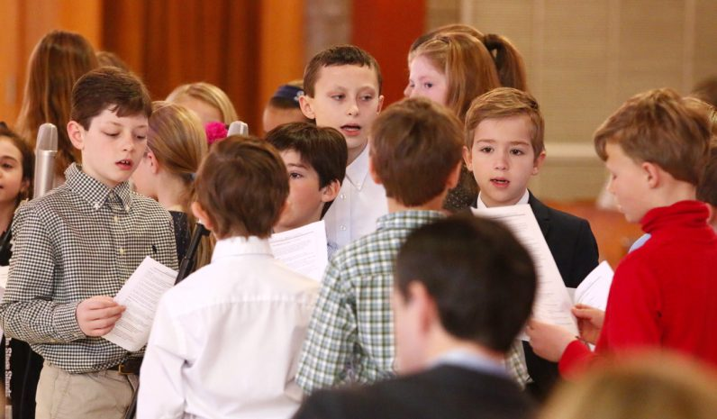 The children's choir provides music for the 9:30 a.m. Mass at St. Katharine of Siena Church in Wayne.