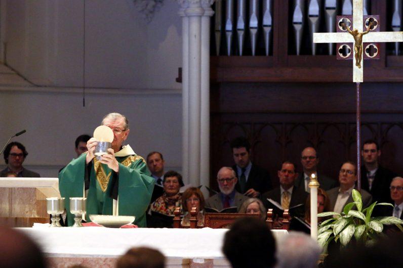 Augustinian Father Michael Hughes celebrates Mass at St. Thomas of Villanova Church.