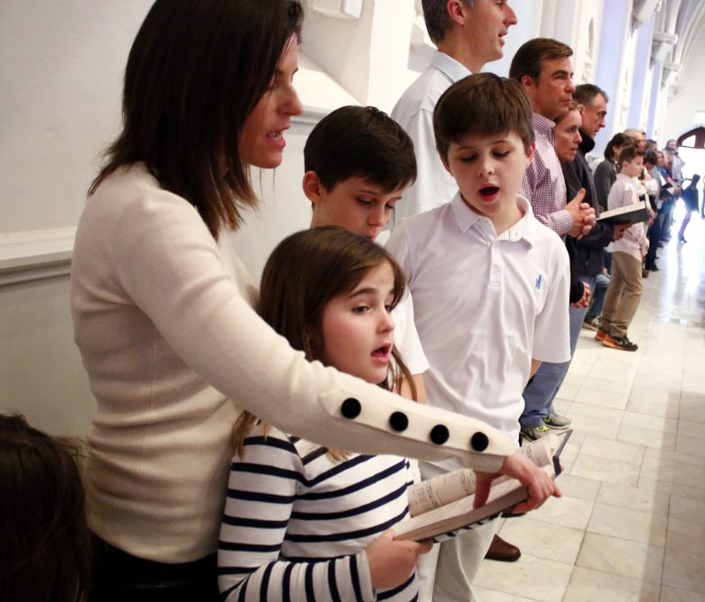 The Rouse family sings together at St. Thomas of Villanova Church.