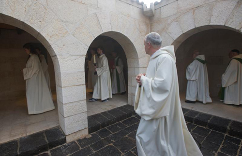 Monks process into the Church of Loaves and Fishes for Mass Feb. 12 in Tabgha, Israel. Twenty months after having suffered serious damage from an arson attack, the atrium of the Benedictine church was reopened. (CNS photo/Atef Safadi, EPA)