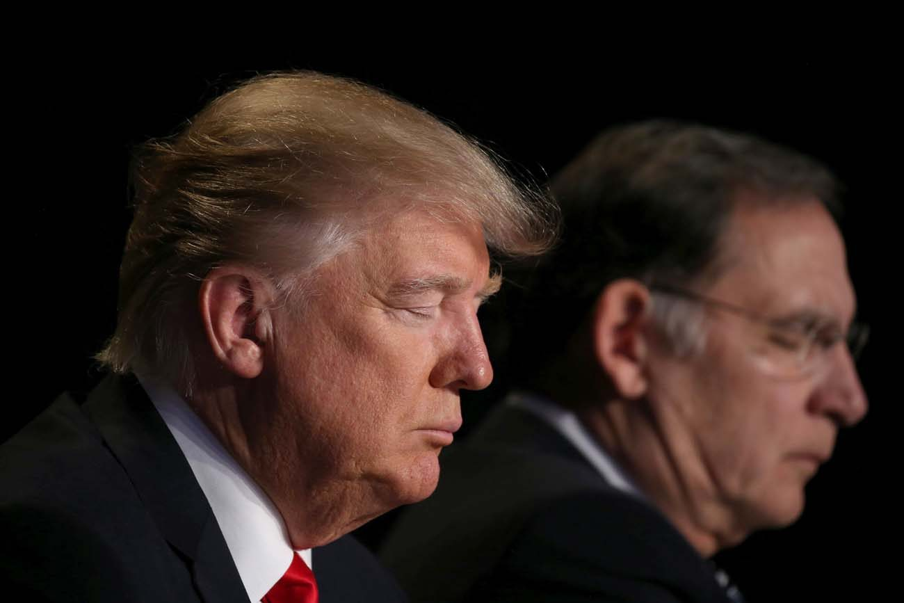 U.S. President Donald Trump prays during the National Prayer Breakfast Feb. 2 in Washington. (CNS photo/Carlos Barria, Reuters)