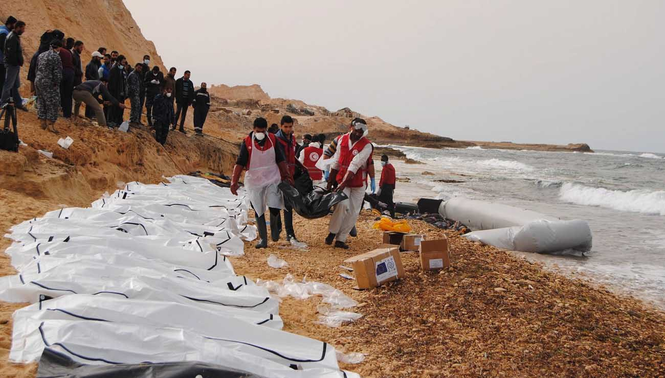 A handout photo made available by the Libyan Red Crescent shows volunteers of the Red Crescent recovering bodies washed ashore at the coast near Al Zawiya, Libya, Feb. 20. Pope Francis' recent statements calling for a welcoming attitude to refugees and migrants hit a nerve on social media. (CNS photo, EPA/Libyan Red Crescent)