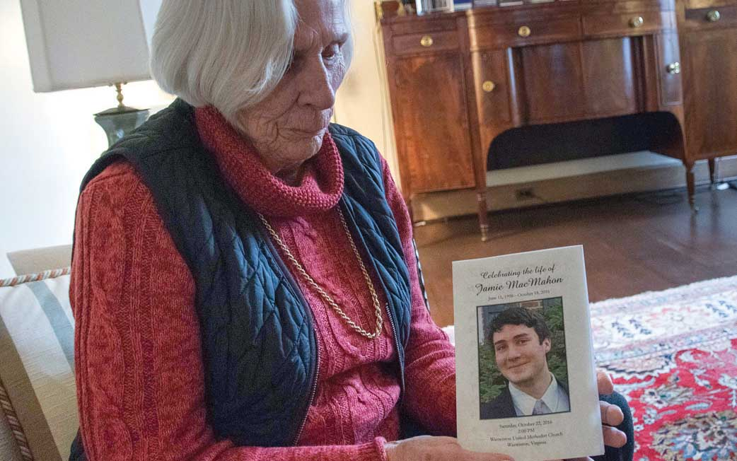 Ann MacMahon holds a funeral program Feb. 1 for her deceased grandson Jamie, who died of an accidental opioid overdose in Broad Run, Va., last October at age 18. (CNS photo/Zoey Maraist, Catholic Herald)