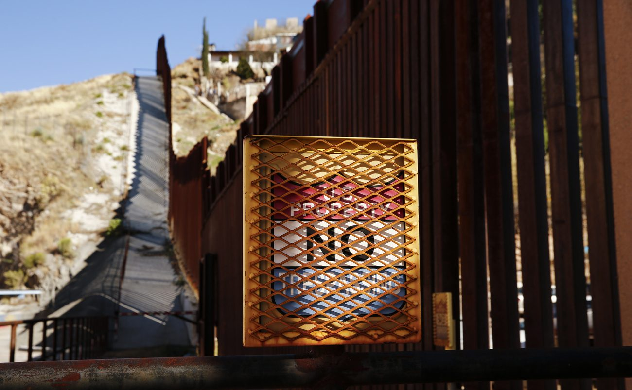 "A ""No Trespassing"" sign is situated along the steel bollard border fence in Nogales, Ariz., Feb. 19. (CNS photo/Nancy Wiechec)"