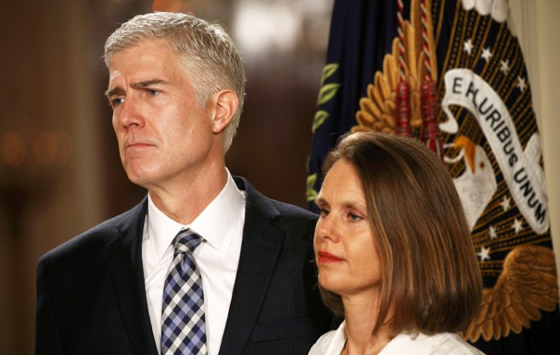 Judge Neil Gorsuch stands with his wife, Marie Louise, at the White House in Washington Jan. 31 as U.S. President Donald Trump announces his nomination of the jurist to be a U.S. Supreme Court justice. If confirmed, Gorsuch will fill the seat that has been empty since the death of Justice Antonin Scalia last February. (CNS photo/Kevin Lamarque, Reuters)