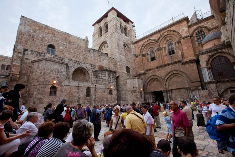 Pilgrims gather outside the ancient Church of the Holy Sepulcher in the Old City of Jerusalem. When did Christians actually get church buildings, built for the purpose of worship? Not until the middle of the third century -- no later than 260. (CNS photo/Jim Hollander, EPA)