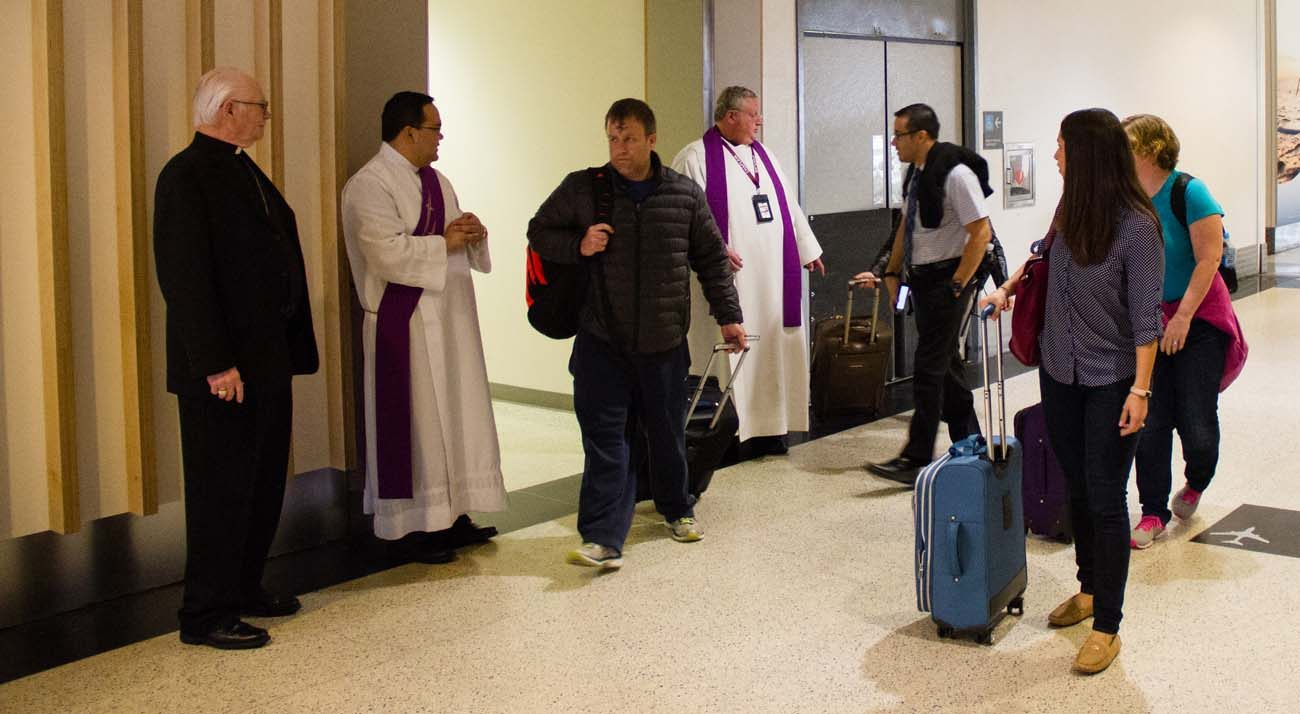 A traveler walks out of the Interfaith Chapel after receiving his ashes on Ash Wednesday at Bush Intercontinental Airport in Houston March 1. (CNS photo/James Ramos, Texas Catholic Herald)