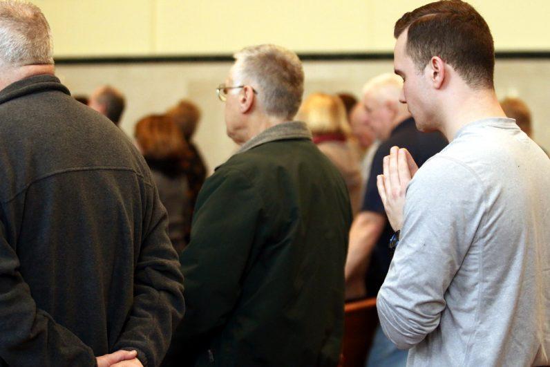 Ryan Meehan, from Sicklerville, N.J., prays during Mass.
