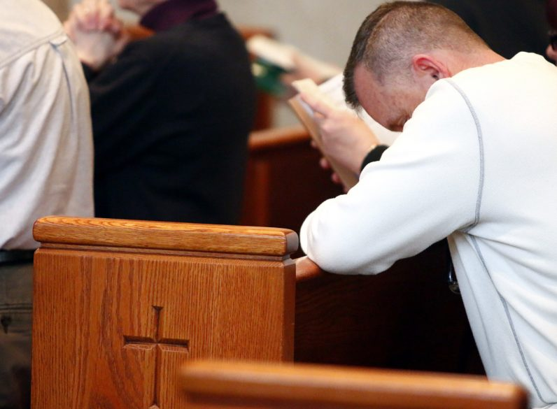 Tom Gallagher from St. Rita Church in South Philadelphia prays during the Mass.