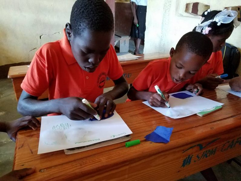 Children learn at their school with the support of Anne Hoppenot's KONEKTE non-profit organization.