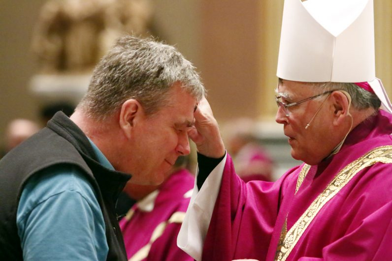 Geoffrey Wade receives ashes from Archbishop Charles Chaput.