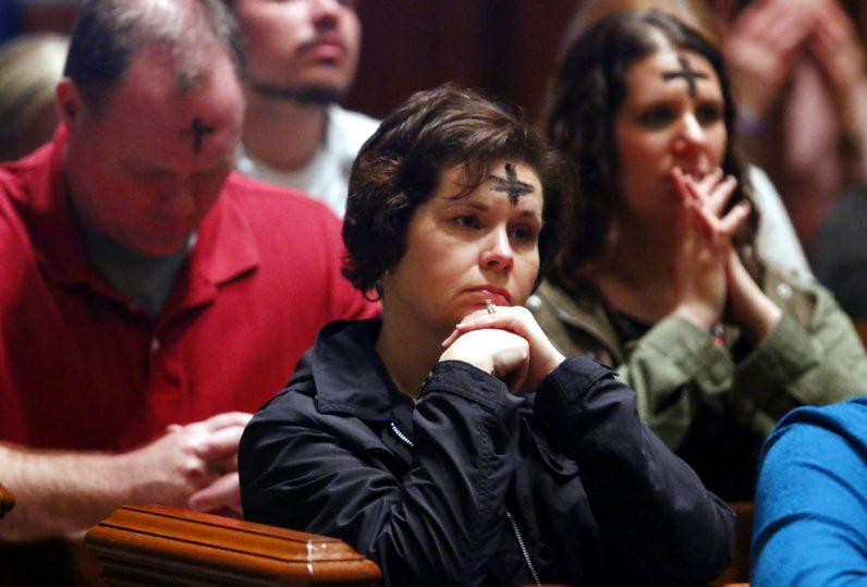 Stephanie Wills from St. Genevieve Parish in Flourtown prays during Mass.