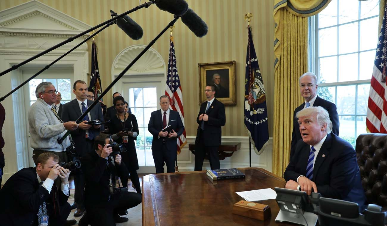 "U.S. President Donald Trump talks to journalists in the Oval Office at the White House March 24 after the American Health Care Act was pulled before a vote. Now that lawmakers have withdrawn the bill, Congress must ""seize this moment to create a new spirit of bipartisanship"" and make ""necessary reforms"" in existing health care law to address access, affordability, life and conscience, said three U.S. bishops' committee chairmen. (CNS photo/Carlos Barria, Reuters)"