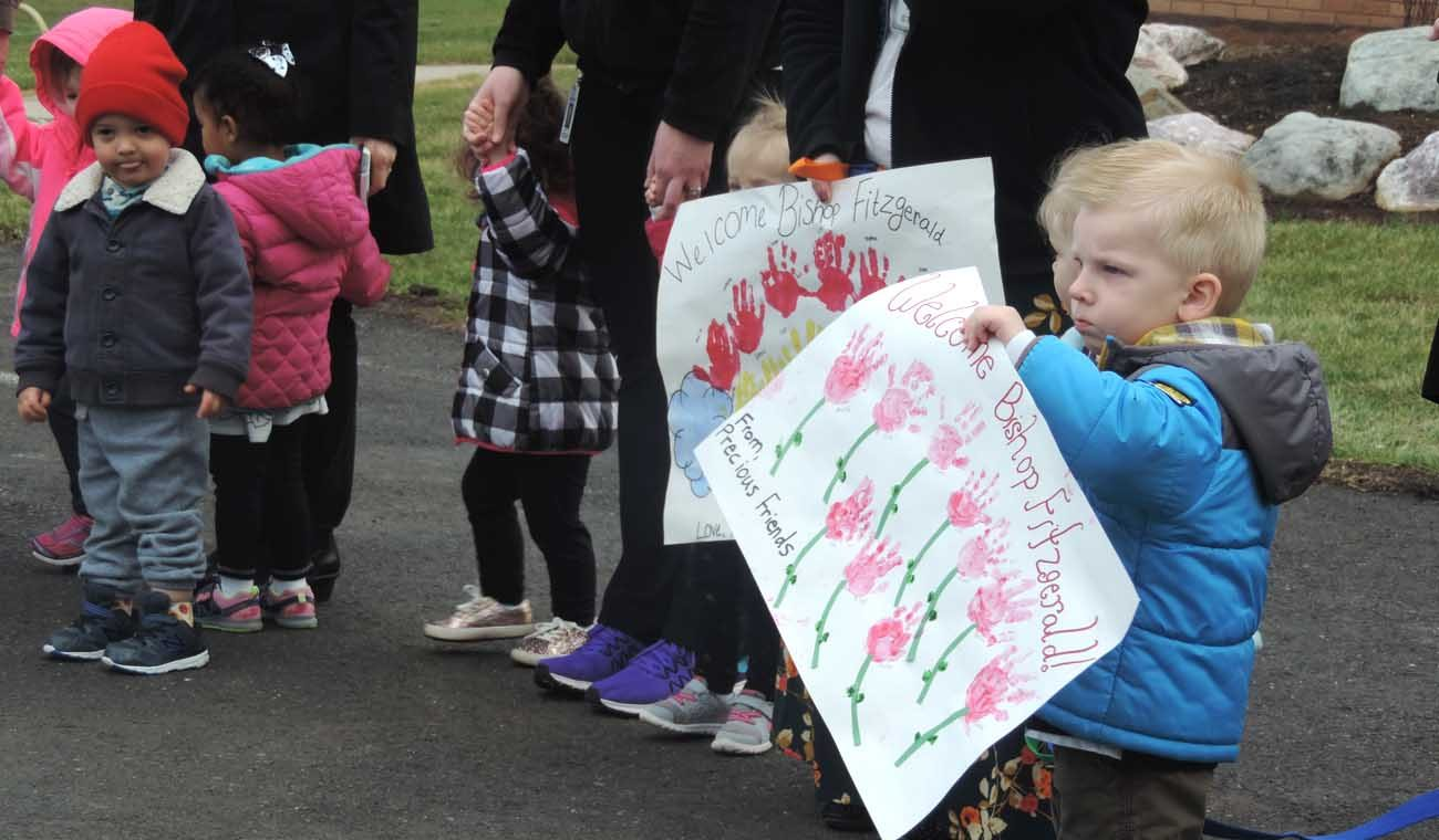 The first class of the Precious Friends of St. Gianna Childcare Center celebrate the facility's dedication on March 30.