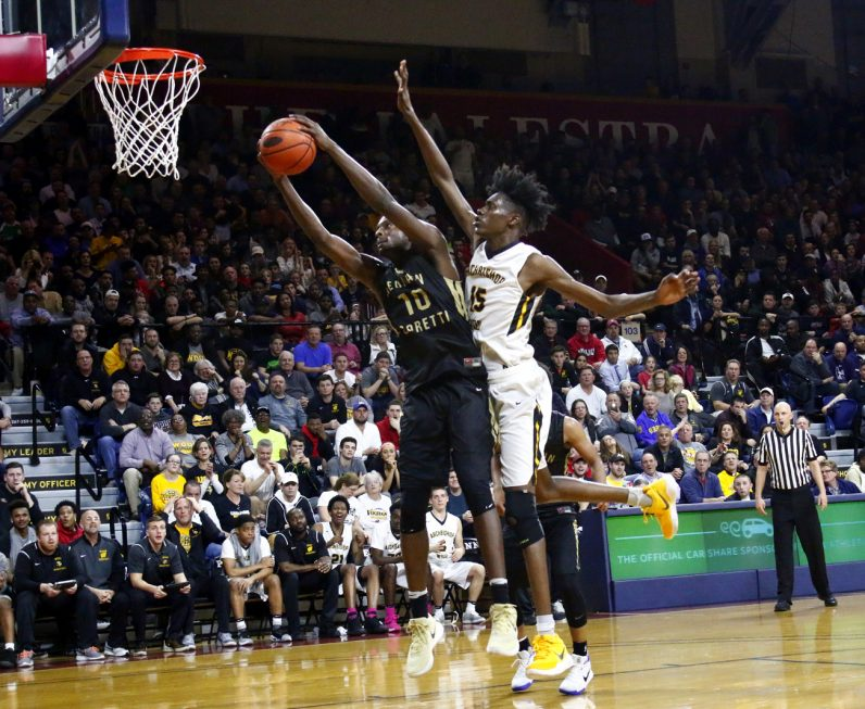 The Vikings' Seth Pinkney attempts to block a shot by the Saints' Dhamir Cosby-Roundtree.