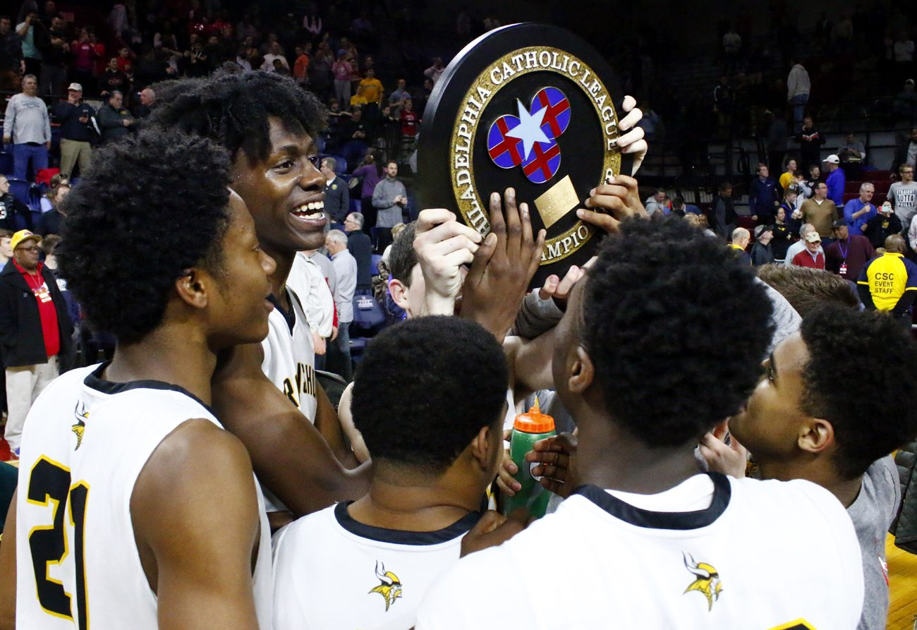Archbishop Wood hoists the Catholic League championship plaque,  their first boys' basketball title in the school's 51-year history, and in improbable fashion. (Sarah Webb)