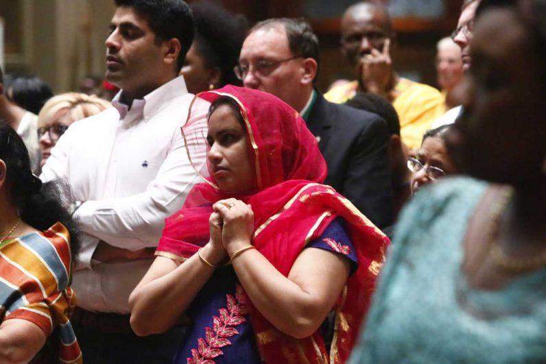 Sheethal Jos from the Indian Knanaya community prays.