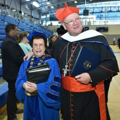 Neumann University President Rosalie Mirenda stands with Cardinal Timothy Dolan at the Charter Day festivities March 15.